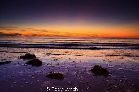 Sunset taken just north of Cape May New Jersey in Sept 20... by Toby Lynch