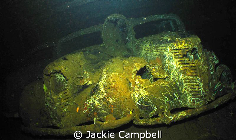 Three Fiat cars on the wreck of the Umbria. They are quit... by Jackie Campbell