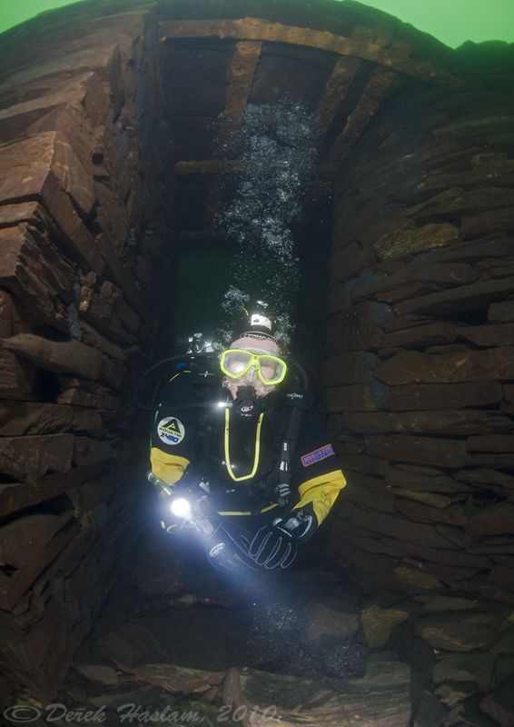Diver in blast hut. Vivian quarry. D3, 16mm. by Derek Haslam