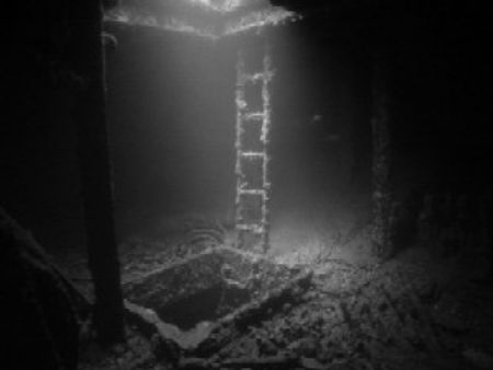 This picture was taken on the Thistlegorm. The hatch on t... by Marco Giovannini