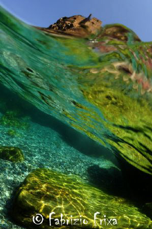 Reflections and transparencies to return for a dive. by Fabrizio Frixa