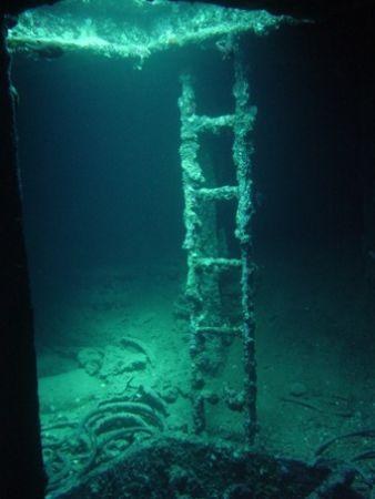 Picture is taken inside the bow of the Thistlegorm in Egypt. by Jj Waanders