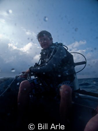 Dive leader, on the way to Fast Eddie's.  Coral Sea. by Bill Arle