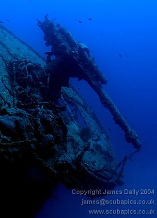 Anti-aircraft gun on the Thistlegorm, Red Sea. by James Dally