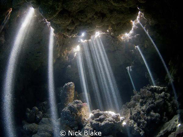 A spectacular natural light show in the caves of Jackfish... by Nick Blake