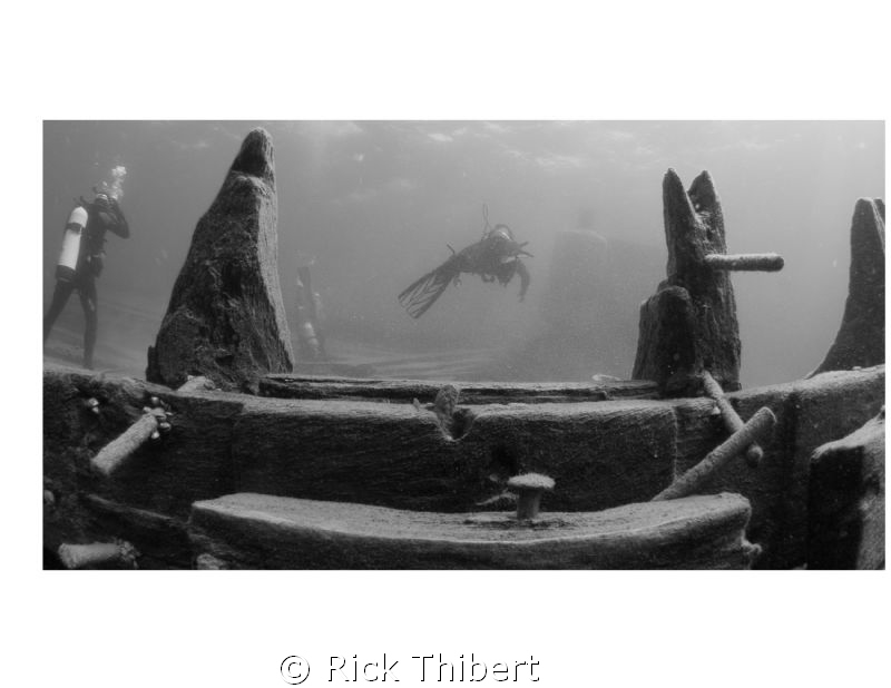 DIVERS AROUND A WRECK by Rick Thibert