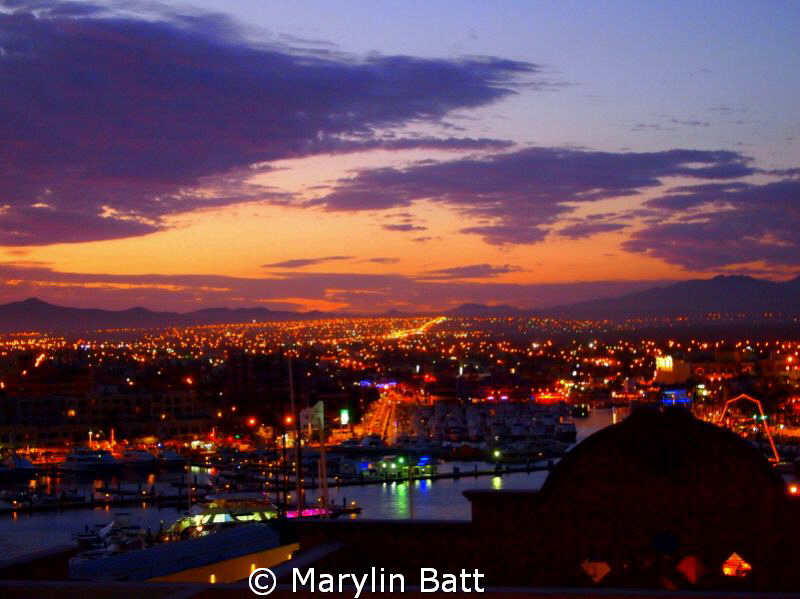 Cabo Sunset. View from the pool over the marina after a d... by Marylin Batt