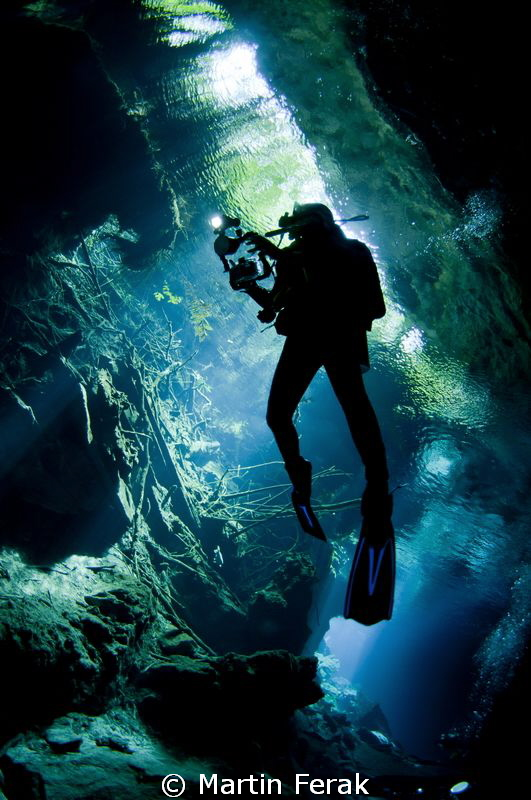 Silhouete from cenote by Martin Ferak