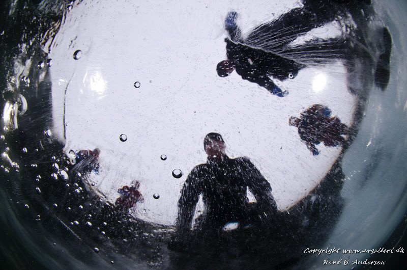 Ice dive, the picture is taken from below through 30 cm o... by Rene Braband Andersen