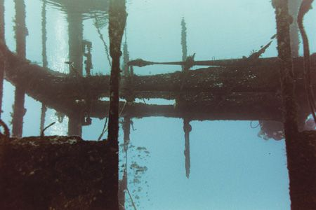 Doc Paulsen. Grand Cayman. Parts of the wreck is mirrored... by Jacques Miller