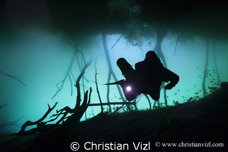 Cave diver at cenote Aktun Ha, Quintana Roo, Mexico by Christian Vizl 