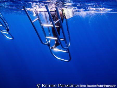 blue water in orange canyon , cayman islands by Romeo Penacino