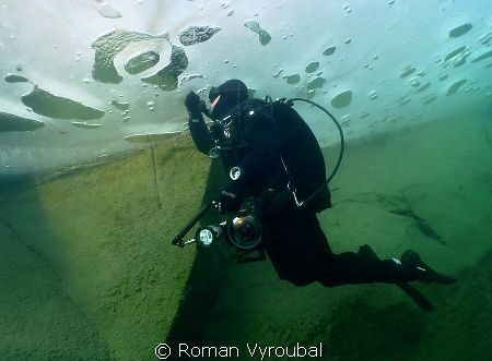 Under the ice. The exhaled air under the ice, we were in... by Roman Vyroubal