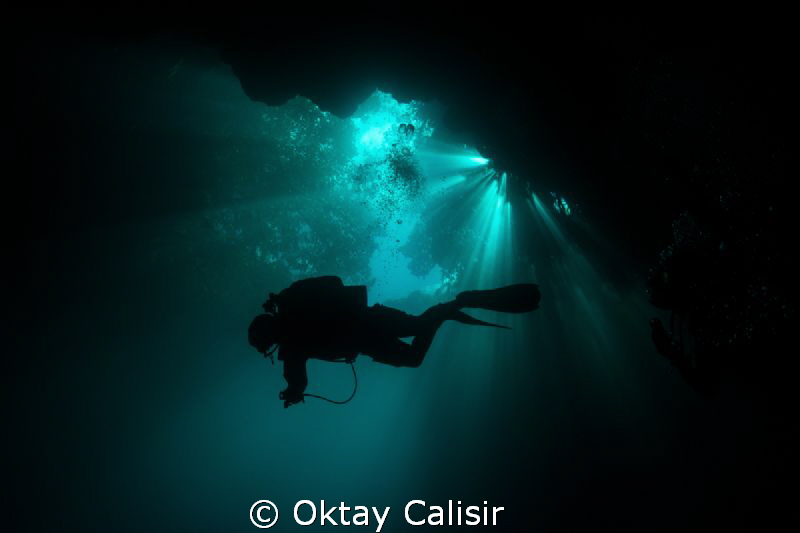 Silhouette of Cave Diver in Mexico - Cenotes by Oktay Calisir