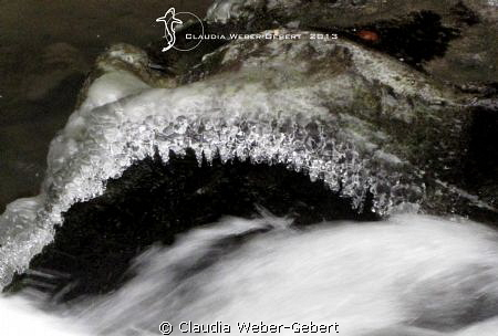 Ice sculptures at a waterfall by Claudia Weber-Gebert