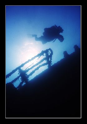 Diver checking out the upper deck of a wreck off the coas... by Johannes Felten