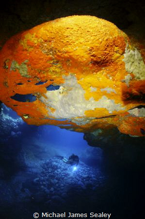 Diver in a volcanic cave by Michael James Sealey