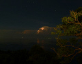 This is one of Koh Tao's most popular dive sites at night from on high and with an electrical storm in the background.