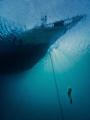 Free diver ascending anchor chain Silolona