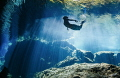 scuba diver dives look around whilst freediver inside. was real joy share time water such young spirit he gracefully moved through one breath. inside breath.' breath' breath