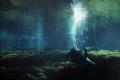 Taken Ginnie Springs FL. Diver top cavern. natural light. FL cavern light