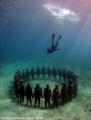 Divemaster Gary free dives down vicissitudes statue installation. Sculptures Jason deCaires Taylor installation