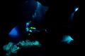 Divers enter Swiss Cheese Dive site Menorca