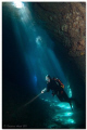 SpotlightThis photo made cave called Himmelsloch located westcoast Corfu Island. ceiling collapsed long time ago let sunbeams in. -Spotlight- Spotlight Island in
