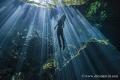 Morning sun rays Cenote Cristalino Quintana Roo Mxico. model was freediving amazed awe beauty this spectacular natural wonders. México. México wonders