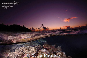 Maldives sunset by Oscar Miralpeix