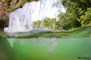 Behind the waterfall by Raoul Caprez
