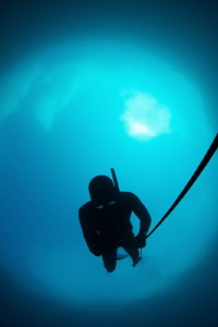 Free diver against Snell's window or astronaut in space? ... by Paul Colley