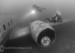Divers on plane.