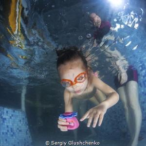 Children swimming by Sergiy Glushchenko