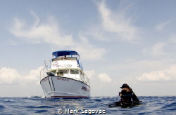 Boat Pickup Drift diving of the the coast of Jupiter Flo... by Mark Sagovac