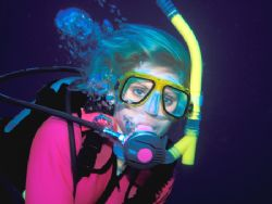 """Pretty in Pink"" - Pretty diver in pink wetsuit models in... by Laszlo Ilyes"