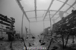 The eerily quiet remnants of the upper deck of an unident... by Byron Dilkes