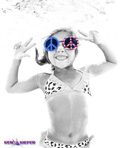 My niece goofing around underwater in the pool.   She's j... by Ken Kiefer