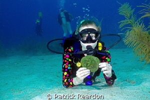 Daughter, Jenny, with a sand dollar. by Patrick Reardon