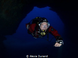 Diver in the Cathedral, Cavern on Lanzarote. by Alexia Dunand