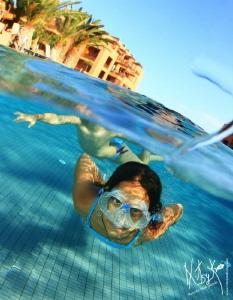Playing in the swimming pool by Natasha Maksymenko