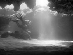Swim through @ North Shore Oahu. by Glenn Poulain