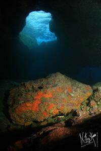 Lots of current inside a cave. Waves on top!, fantastic t... by Natasha Maksymenko
