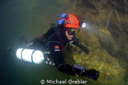 Sidemount diver near the surface after having completed a... by Michael Grebler