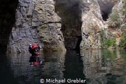 Cave diver at the surface in the cavern section of a floo... by Michael Grebler