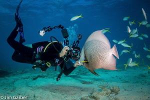 Angle fish whisperer by Jim Garber
