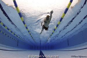 Lone swimmer by Petteri Viljakainen