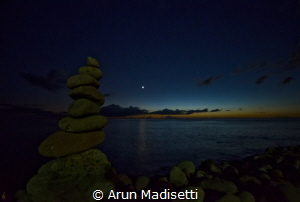 Standing stones and moon by Arun Madisetti