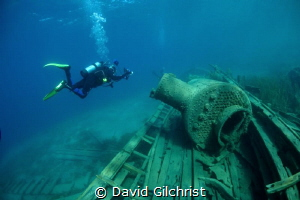 U/W Photographer hovers over wreck of the steam tug, 'Ali... by David Gilchrist