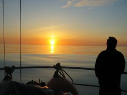sunset at sea - notice the flatness of the sea...it's rig... by David Abecasis